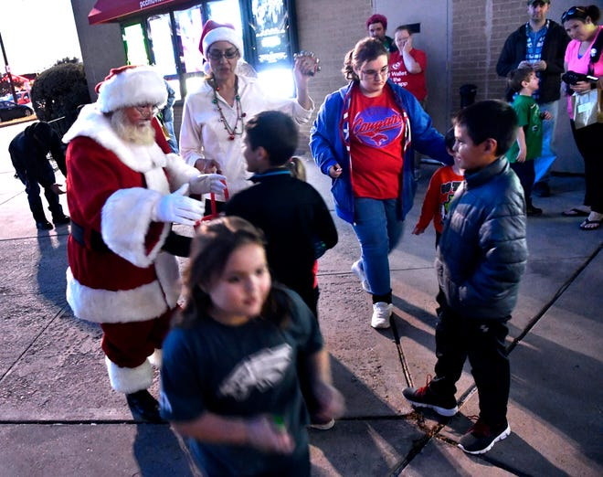 Santa Claus is greeted Friday by children at the Mall of Abilene. His arrival heralds the beginning of the holiday season. Santa will be available for consultation and photographs from now until Christmas Eve, excluding Thanksgiving.