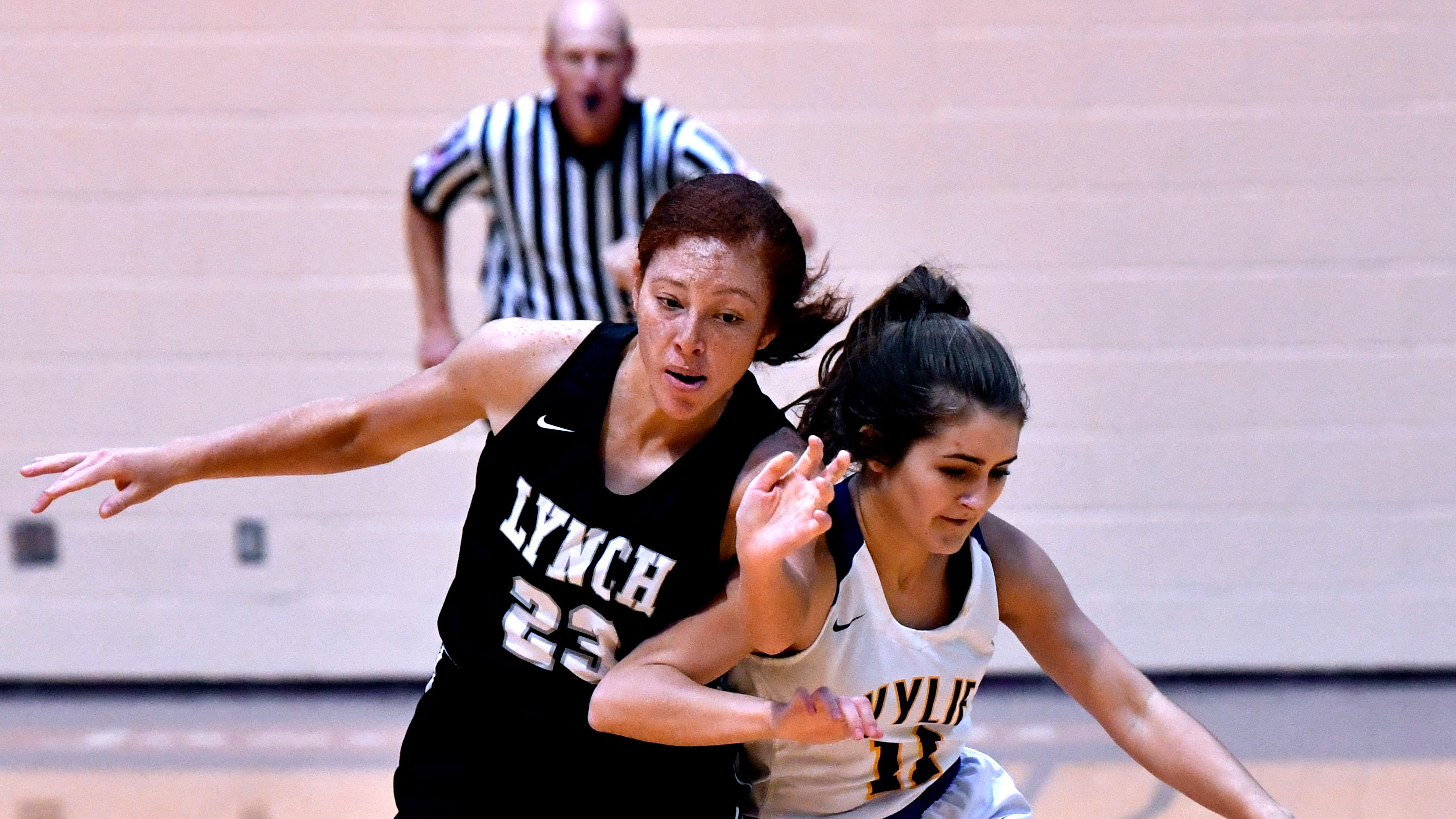 Wylie High School's Madi Latham fends off Bishop Lynch's Jaida Thomas during the final game of the Polk-Key City Basketball Classic at Hardin-Simmons University Saturday Nov. 17, 2018.