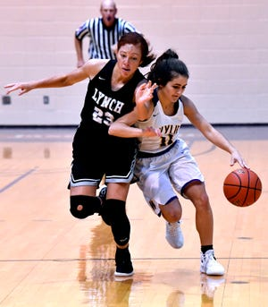 Wylie High School's Madi Latham fends off Bishop Lynch's Jaida Thomas during the final game of the Polk-Key City Basketball Classic at Hardin-Simmons University on Saturday. Bishop Lynch topped the defending champion Lady Bulldogs.