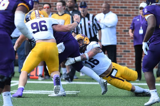 Hardin-Simmons defensive lineman Hunter Creasey (96) and linebacker Chris Miller (16) combine to bring down a Mary Hardin-Baylor ball carrier in the first round of the NCAA Division III playoffs at Crusader Stadium in Belton on Saturday, Nov. 17, 2018.