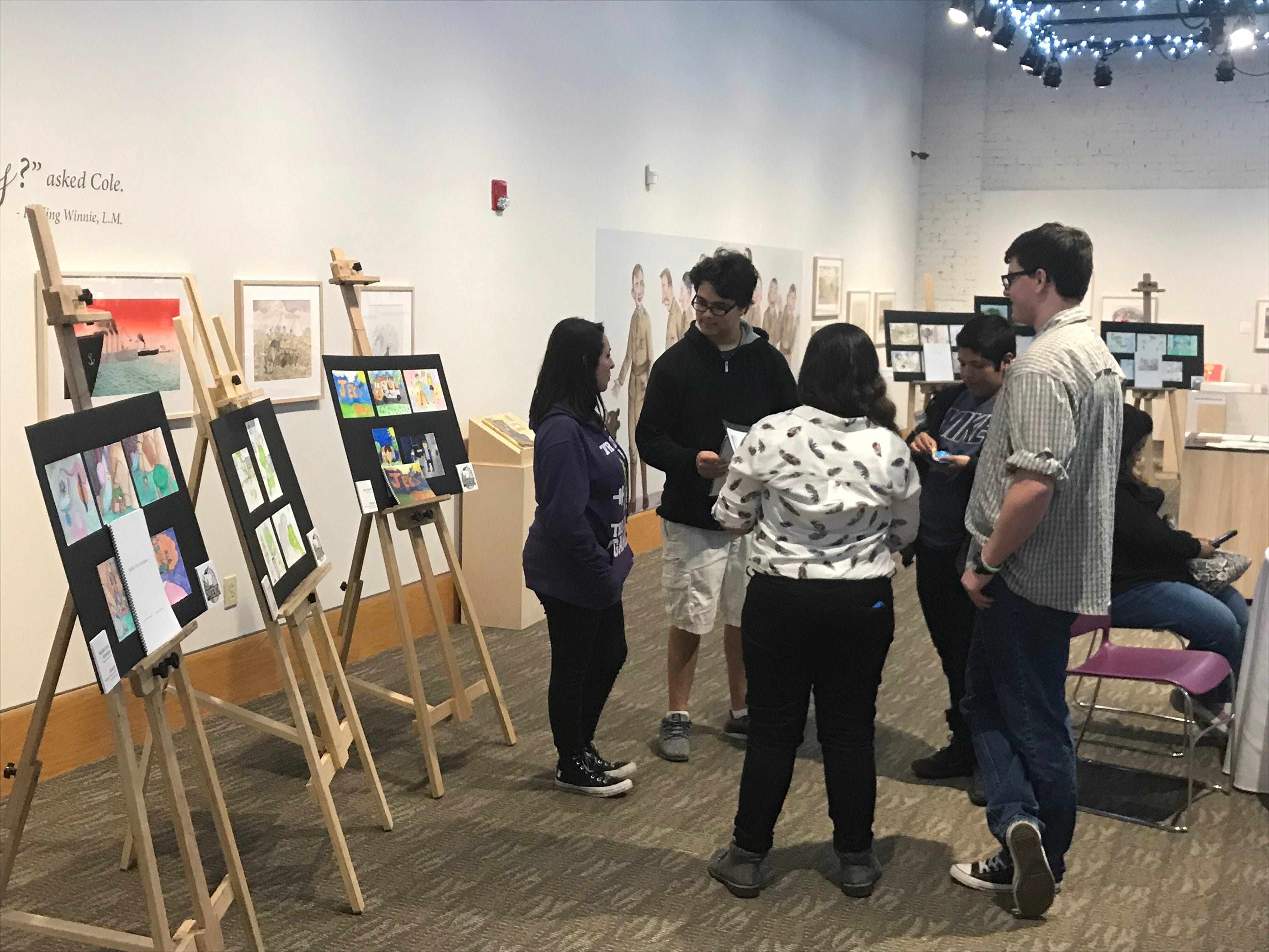 Student works from ATEMS, both art and writing, fit perfectly at NCCIL one-day exhibit