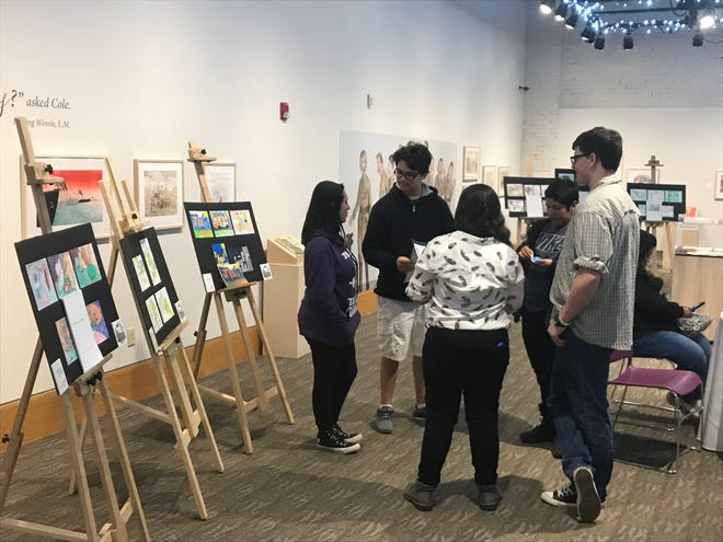 Students of Abilene ISD's ATEMS High School talk about their children's books, which were displayed Thursday at the National Center for Children's Illustrated Literature.