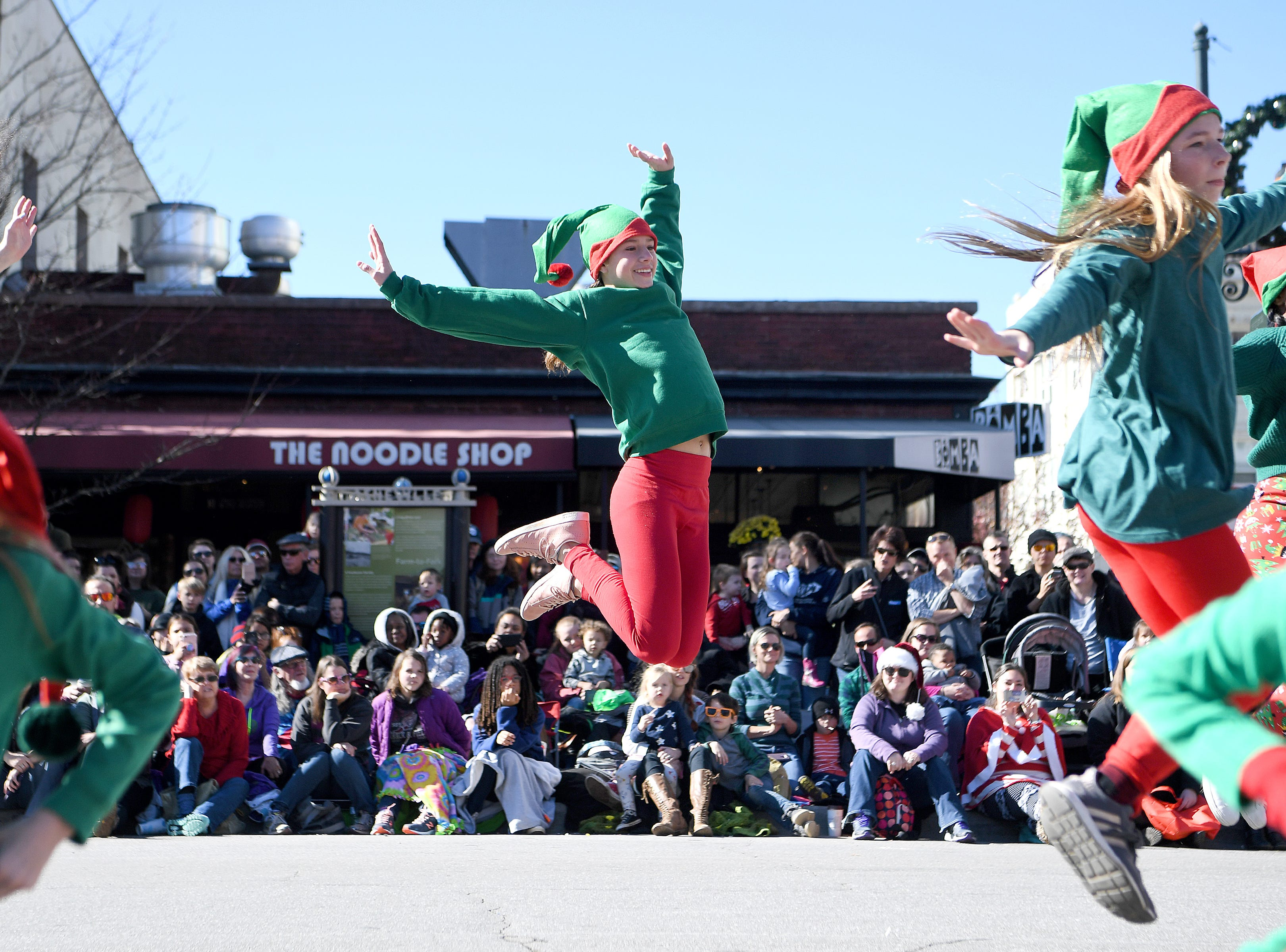 Osega Dream Academy performs for the judges at the corner of Biltmore and Patton Avenues during the 2018 Asheville Holiday Parade on Nov. 17, 2018. More than 100 entries walked through the streets lined with spectators in the parade this year.