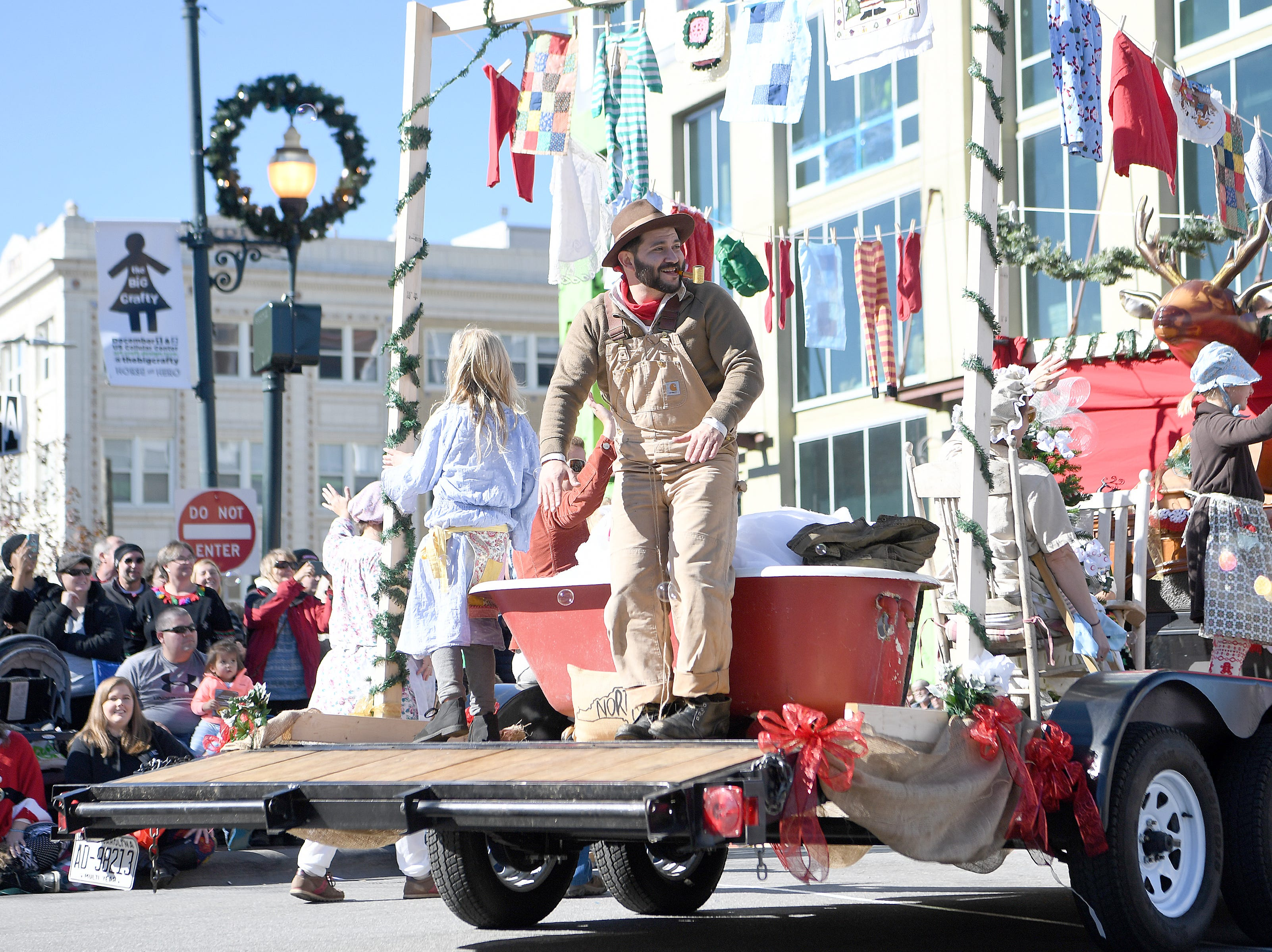 More than 100 entries walked the streets of downtown packed with spectators in the 2018 Asheville Holiday Parade on Nov. 17, 2018.