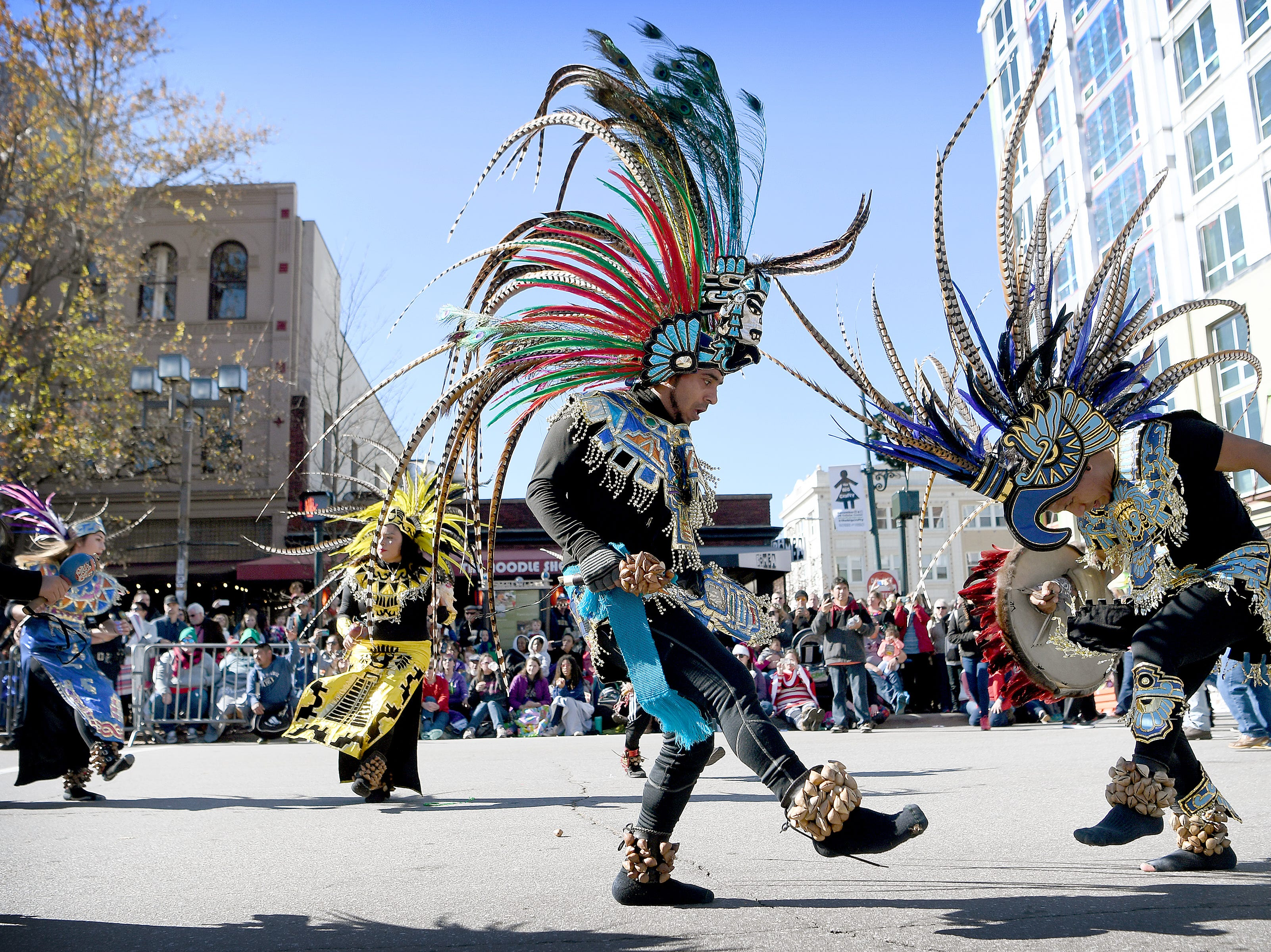 Dancers with Grupa de Danza Guadalupana de Asheville perform for the judges at the corner of Biltmore and Patton Avenues during the 2018 Asheville Holiday Parade on Nov. 17, 2018. More than 100 entries walked through the streets lined with spectators in the parade this year.