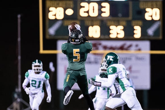 Reynolds' Jhari Patterson makes a catch during their Friday night playoff game against A.L Brown, Nov. 16, 2018.