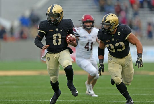 Nov 17, 2018; West Point, NY, USA; Army Black Knights quarterback Kelvin Hopkins Jr. (8) runs with the ball alongside running back Darnell Woolfolk (33) during the second half against the Colgate Raiders. Army beat Colgate 28-14 to remain undefeated at Michie Stadium. Mandatory Credit: Danny Wild-USA TODAY Sports