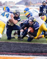 Colton Repsher lays down a powerful block to allow quarterback Jarred Freije to cross the line for a two-point conversion in Saturdays New York State Class C Football Semi Finals game.