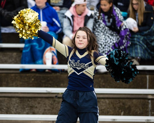 Susquehanna Valley's Phoebe Huffman cheers on her team in the New York State Class C Football Semi Finals game in Endicott Saturday.