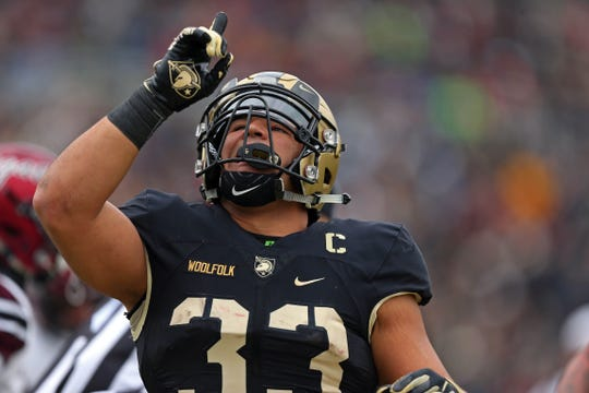 Nov 17, 2018; West Point, NY, USA; Army Black Knights running back Darnell Woolfolk (33) reacts after scoring a touchdown against the Colgate Raiders during the first half at Michie Stadium. Mandatory Credit: Danny Wild-USA TODAY Sports