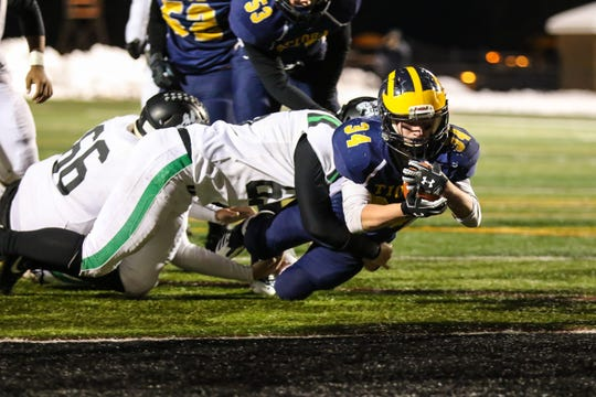 Tioga's Owen Wanck dives across the goal line on a 5-yard scoring run in the fourth quarter against Clymer/Sherman/Panama in Friday's Class D state semifinal at Union-Endicott. The Tigers lost, 54-19.