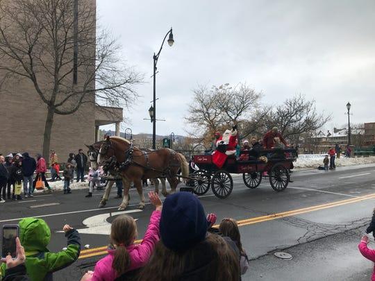 Santa waves to spectators at the Boscov's annual Holiday Parade Saturday in Binghamton.