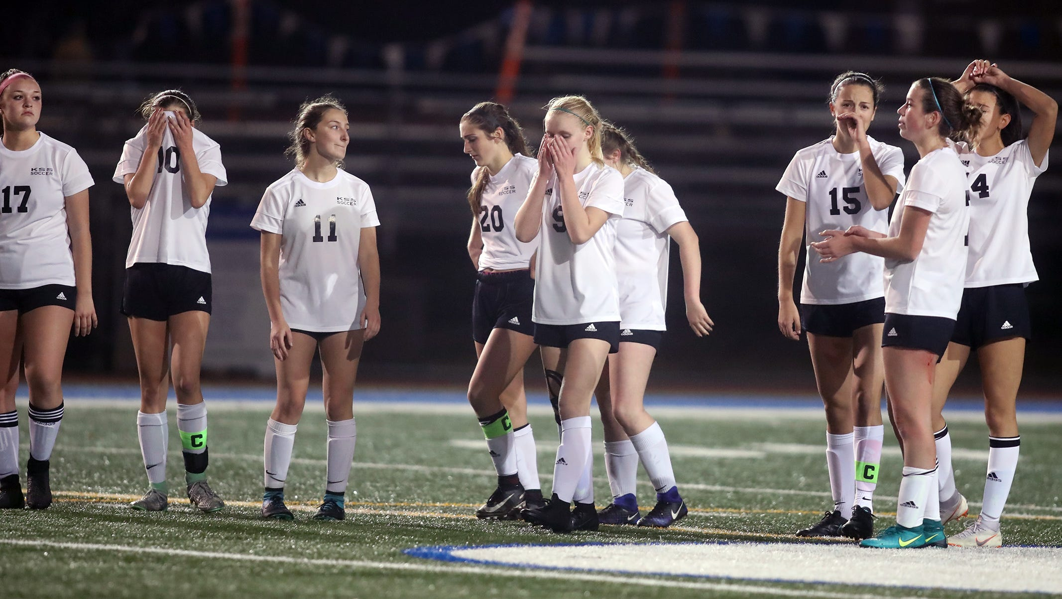 The Klahowya girls soccer shootout kickers react after they lost to King's Way on a shoot out in overtime in the 2018 Girls Soccer State Championship 1A semifinal game at Shoreline Stadium on Friday, November 16, 2018.