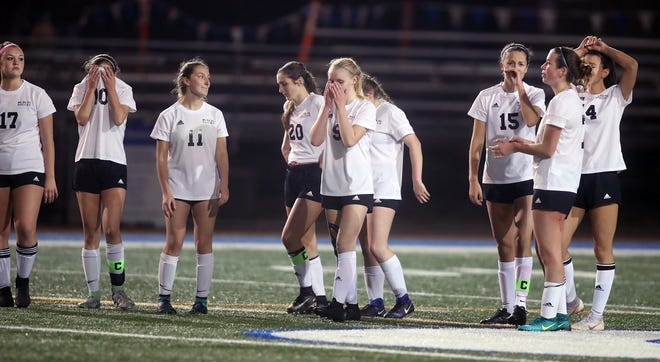 Klahowya players react to the team's shootout loss against King's Way Christian on Friday in a Class 1A semifinal game at Shoreline Stadium.