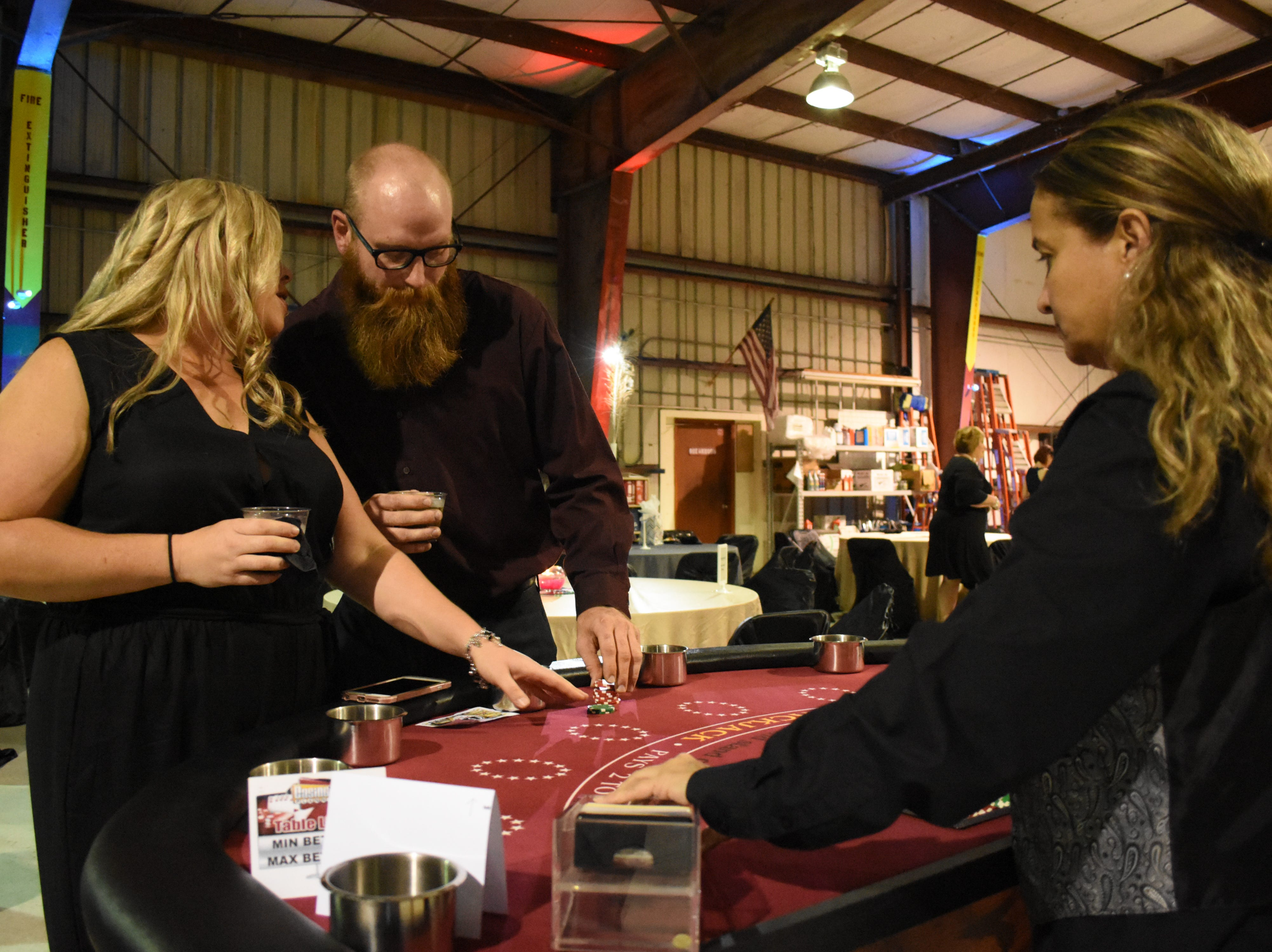 Amanda Tacinaand  Joshua Holton discuss strategy while playing blackjack.