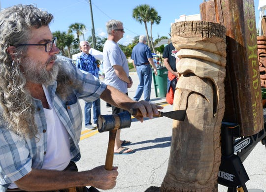 Ed Volonnino carves a tiki head during ArtWorks 2018 in the Eau Gallie Art District.
