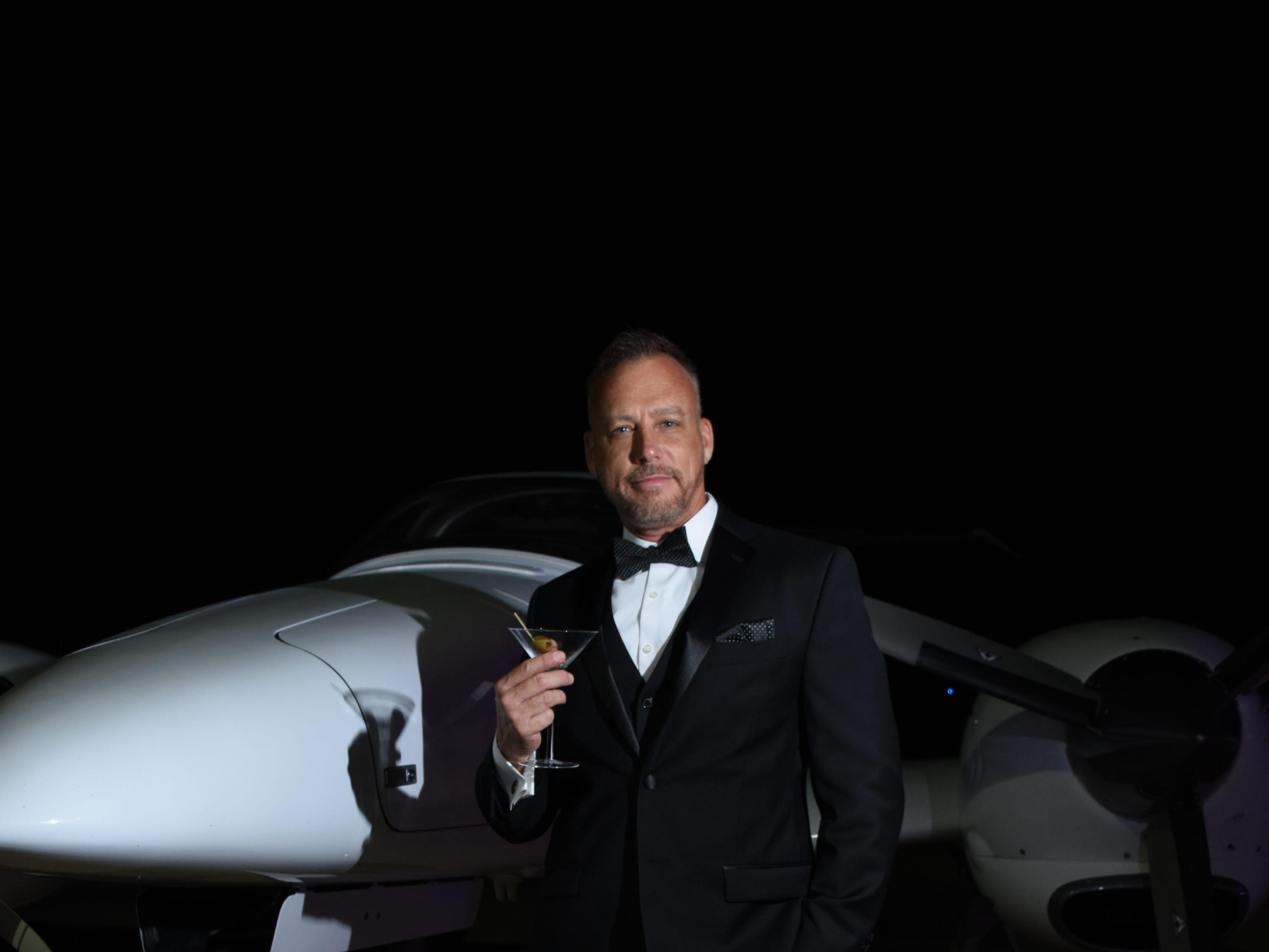 "Playing ""007"" Joe Clark poses for a photo with his shaken not stirred martini."
