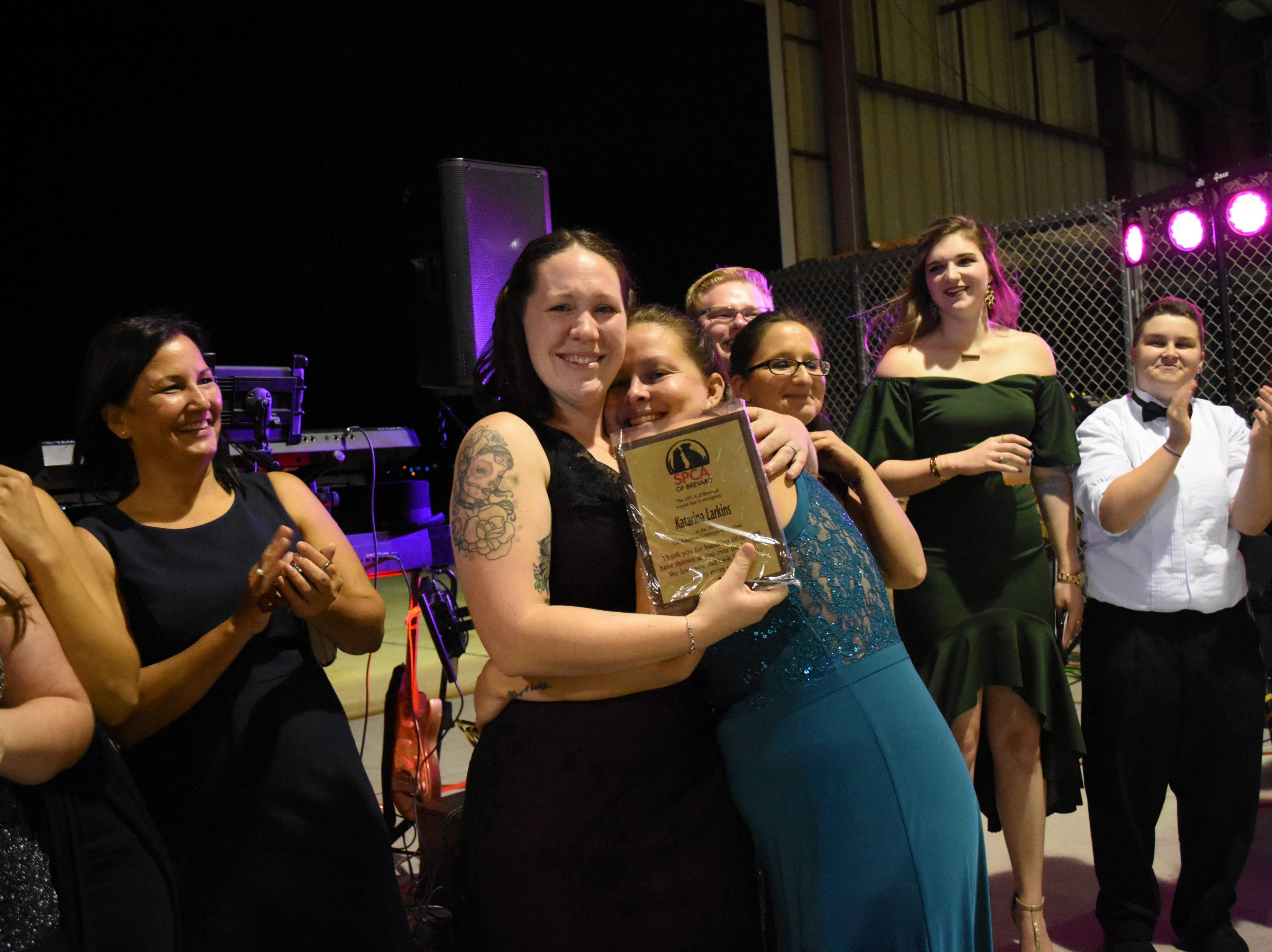 Katrina Larkins is awarded the cat adoption employee of the year award.
