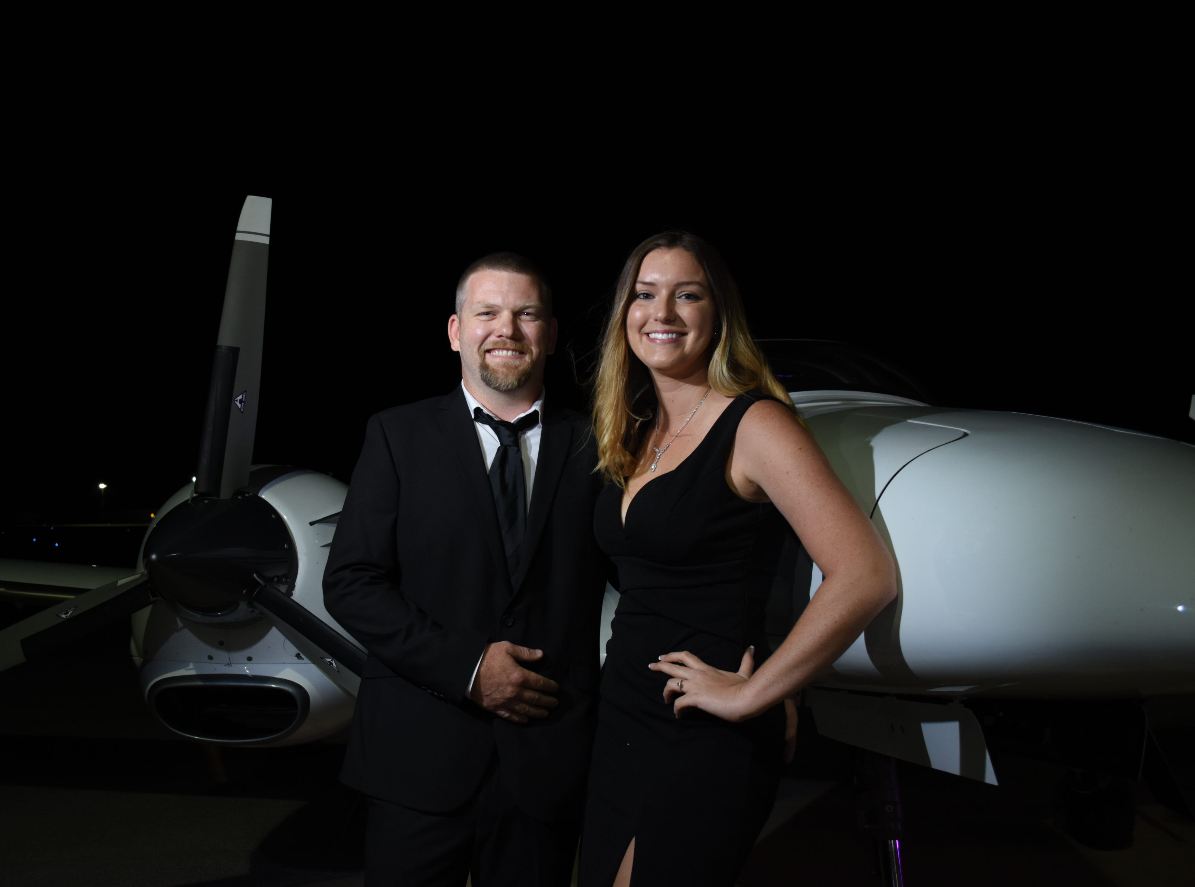 Jamey Blythe and Ashley Bussberg pose for a photo.