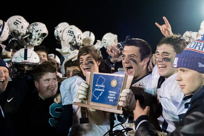 Shawnee celebrates a 17-14 overtime win against Clearview, earning a South Jersey Group 4 title Friday, Nov. 16, 2018 at Clearview High School in Mullica Hill, N.J.