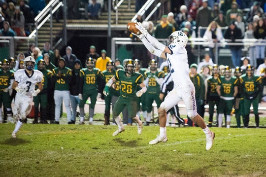 Shawnee's Nate Summerville (12) makes a reception in overtime Friday, Nov. 16, 2018 in a South Jersey Group IV title game at Clearview High School in Mullica Hill, N.J. Shawnee won 17-14.