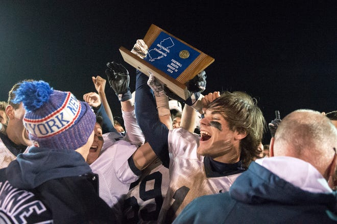 Shawnee's Joey Moore lifts the trophy following a 17-14 overtime win against Clearview, earning a South Jersey Group 4 title Friday, Nov. 16, 2018 at Clearview High School in Mullica Hill, N.J.