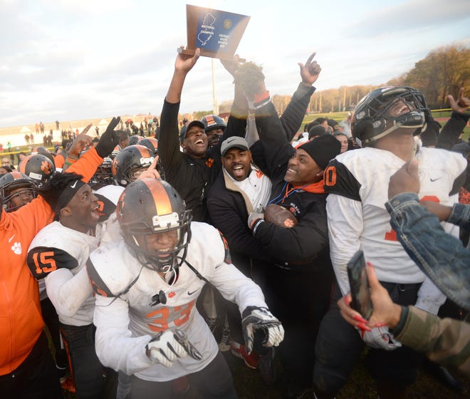 Woodrow Wilson players and coaches celebrate after capturing the South Jersey Group final, defeating Burlington Township 22-14 at Burlington Township High School, Saturday, Nov. 17, 2018.