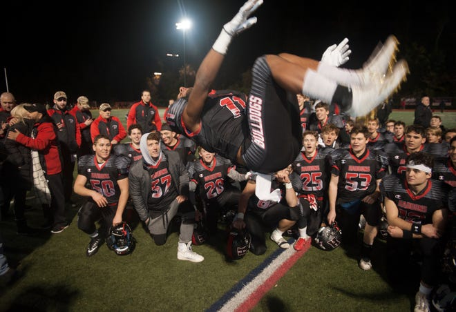 Haddonfield's Luke Colehower does a flip as he celebrates Haddonfield's 23-12 win over Camden High School in the South Jersey Group 2 football championship game on Nov. 16.