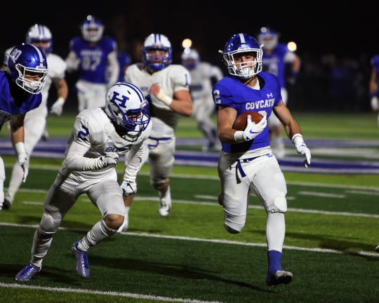 Covington Catholic running back Casey McGinness runs for a touchdown. Covington Catholic defeated Highlands 36-0.