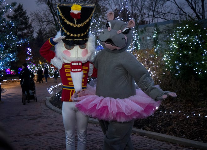 The Nutcracker and Fiona of the Cincinnati Ballet take photos with guests during the 36th annual Festival of Lights at the Cincinnati Zoo.