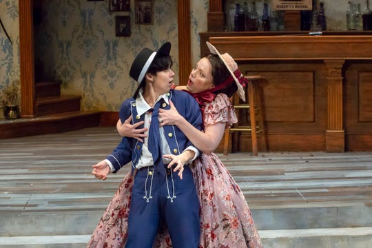 "Abby Lee (R) as Olivia and Caitlin McWethy as Viola in a game-changing scene in Cincinnati Shakespeare Company's production Shakespeare's ""Twelfth Night."" Filled with buffoonish comedy and cases of mistaken identity, the show runs through Dec. 8."