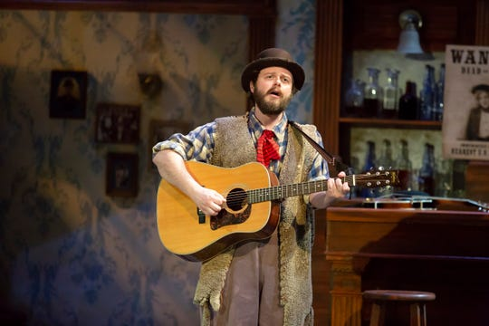 """Cincinnati Shakespeare Company ensemble member Cary Davenport is something of a wandering troubadour in the current production of Shakespeare's """"Twelfth Night,"""" which runs through Dec. 8."""