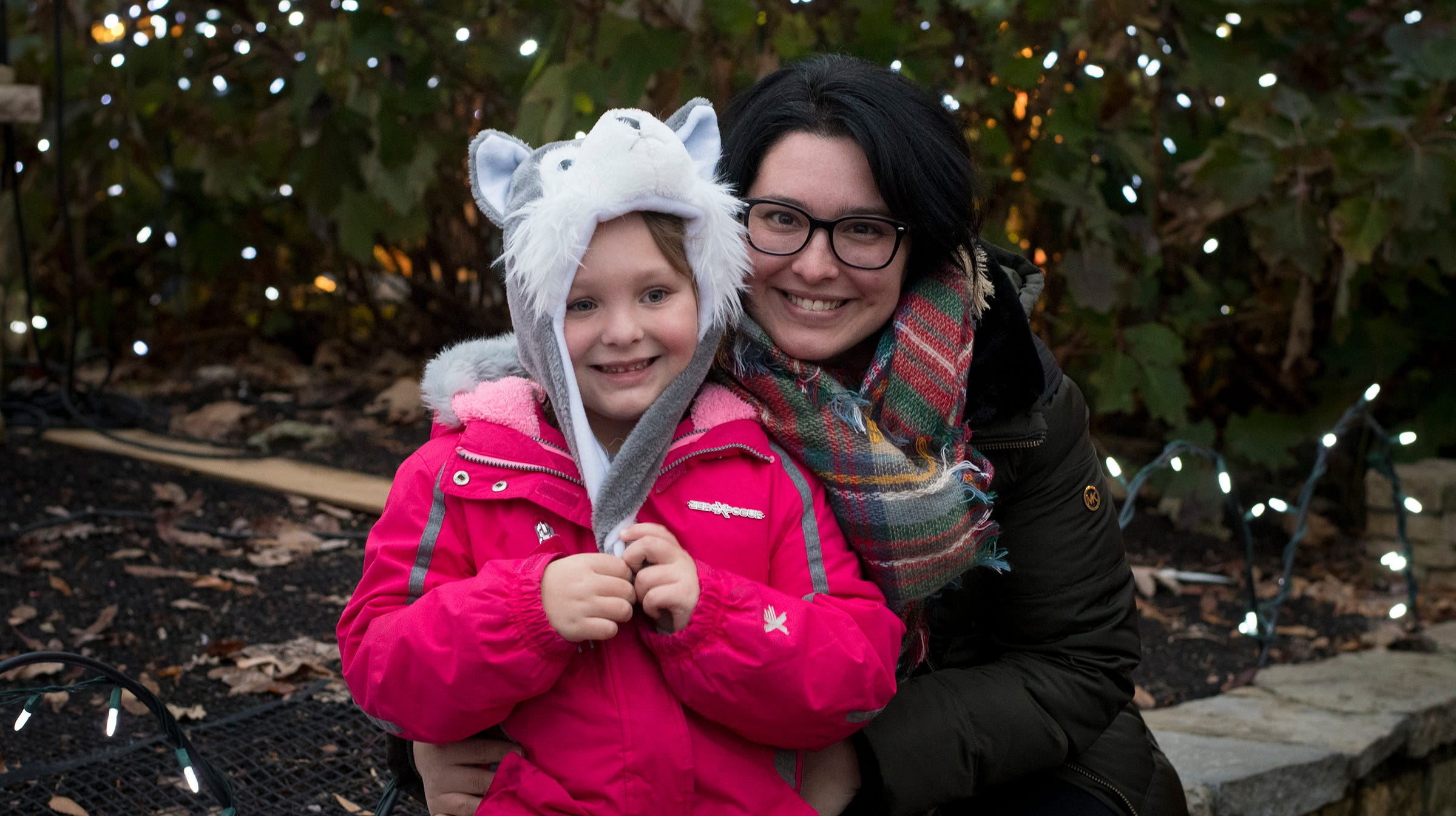 Brittany Wagner and Hadley Gilliland, 4, attend the 36th annual Festival of Lights at the Cincinnati Zoo on Friday.