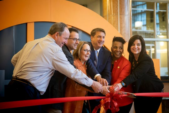 Rep. Catherine Ingram joins in a ribbon-cutting at Union Terminal.