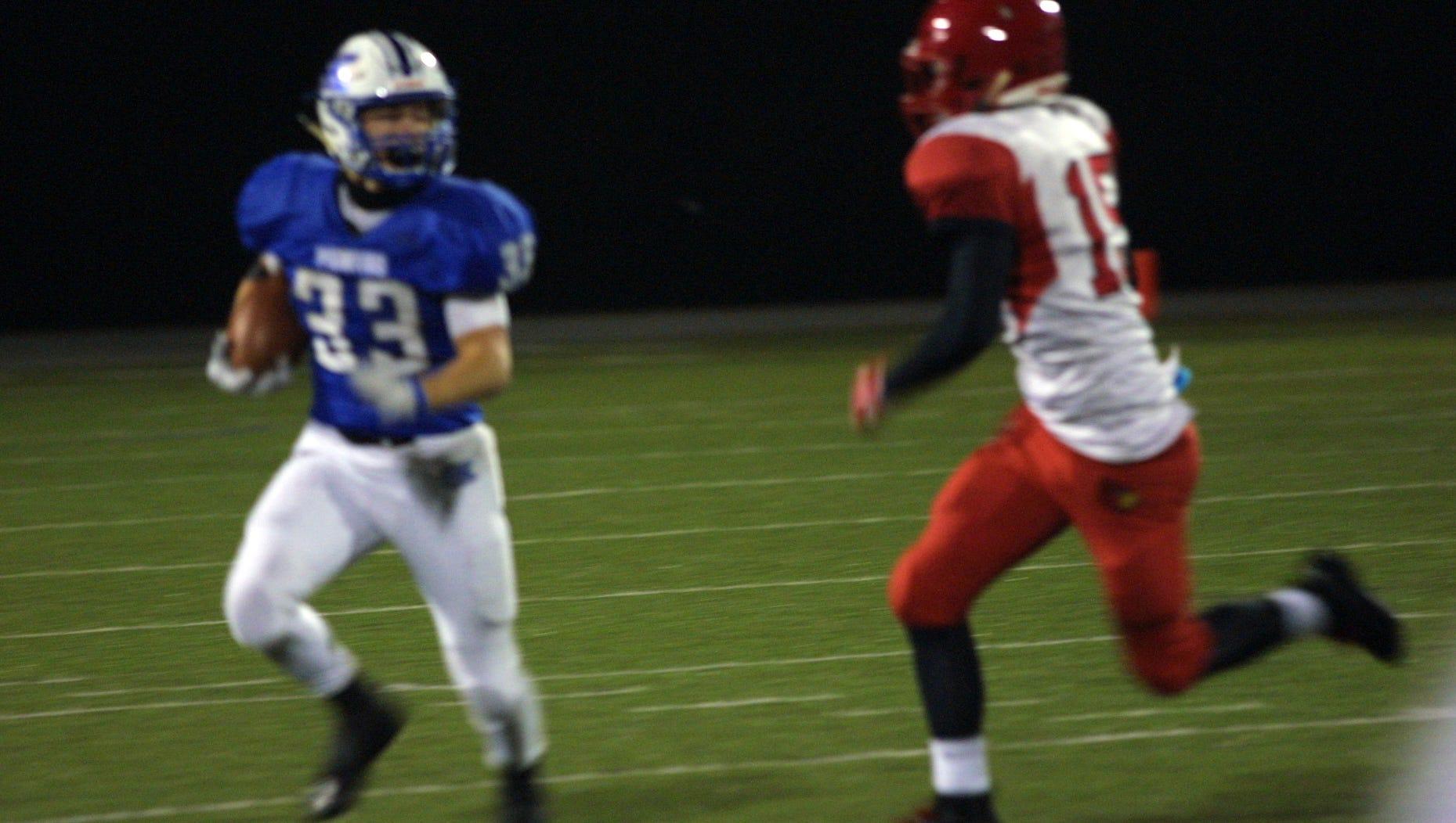 Senior Jon Sergent of Simon Kenton runs for a first down against Scott County in the Kentucky 6A State Football Quarterfinal at Simon Kenton High School, Friday Nov. 16, 2018.