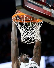 UC center Nysier Brooks dunks in the first half.