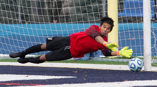 New Providence goalie Miguel Garcia makes one of several saves in regulation against Glassboro in the Group I final on Saturday, Nov. 17, 2018 at Kean University.