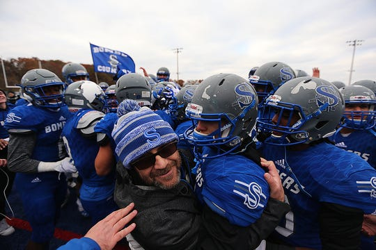 Sayreville celebrates its win Saturday November 17, 2018