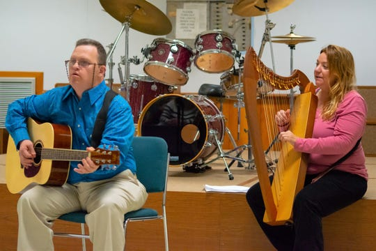 """Scott S. and Patty T. played a musical rendition of """"Ode to Christmas."""""""