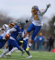 North Brunswick's Baniel Urbina (54) tries to block Sayreville quarterback Mark Whitford during the second half of the Central Group V final on Saturday, Nov. 17, 2018.
