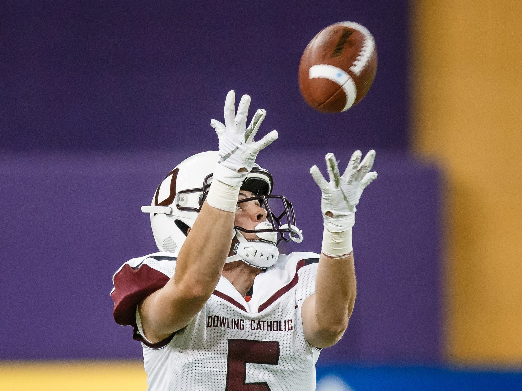 Dowling Catholic's Collin Cook (5) catches a pass during their class 4A state championship football game against Cedar Falls on Friday, Nov. 16, 2018, in Cedar Falls. Cedar Falls takes a 13-7 lead into halftime.