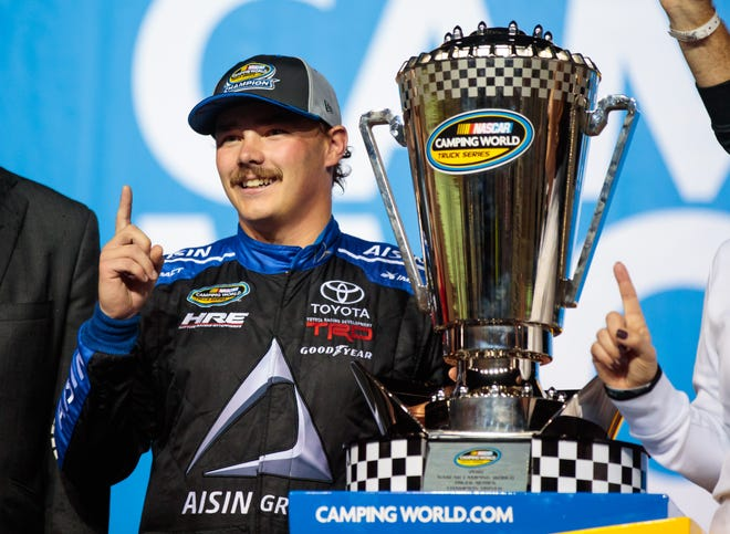NASCAR Camping World Truck Series driver Brett Moffitt, of Grimes, Ia., celebrates after clinching the 2018 truck series championship and winning the Ford EcoBoost 200 at Homestead-Miami Speedway on Nov. 16.