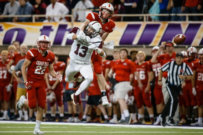 Cedar Falls's Logan Wolf (17) breaks up a pass intended for Dowling Catholic's Jack Lyman (13) during their class 4A state championship football game on Friday, Nov. 16, 2018, in Cedar Falls. Cedar Falls takes a 13-7 lead into halftime.