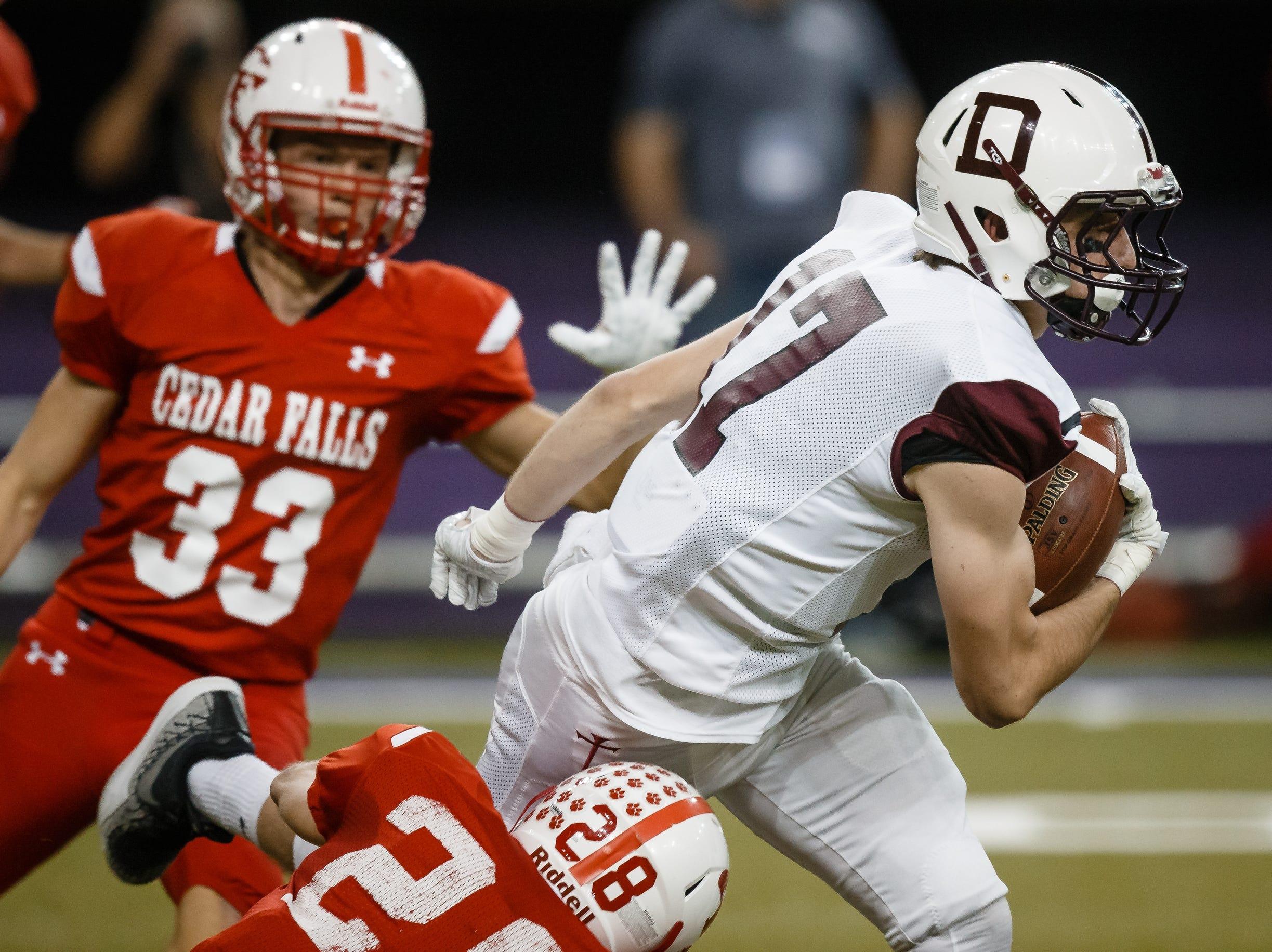 Dowling Catholic's Matt Stilwill (17) runs the ball during their class 4A state championship football game on Friday, Nov. 16, 2018, in Cedar Falls. Cedar Falls takes a 13-7 lead into halftime.