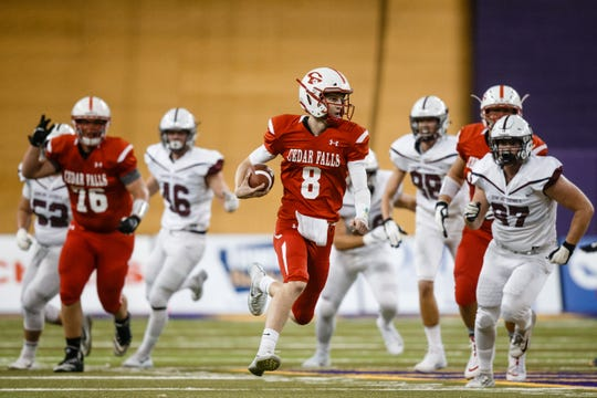 Cedar Falls's Cael Loecher (8) runs the ball during their class 4A state championship football game against Dowling Catholic on Friday, Nov. 16, 2018, in Cedar Falls. Cedar Falls takes a 13-7 lead into halftime.