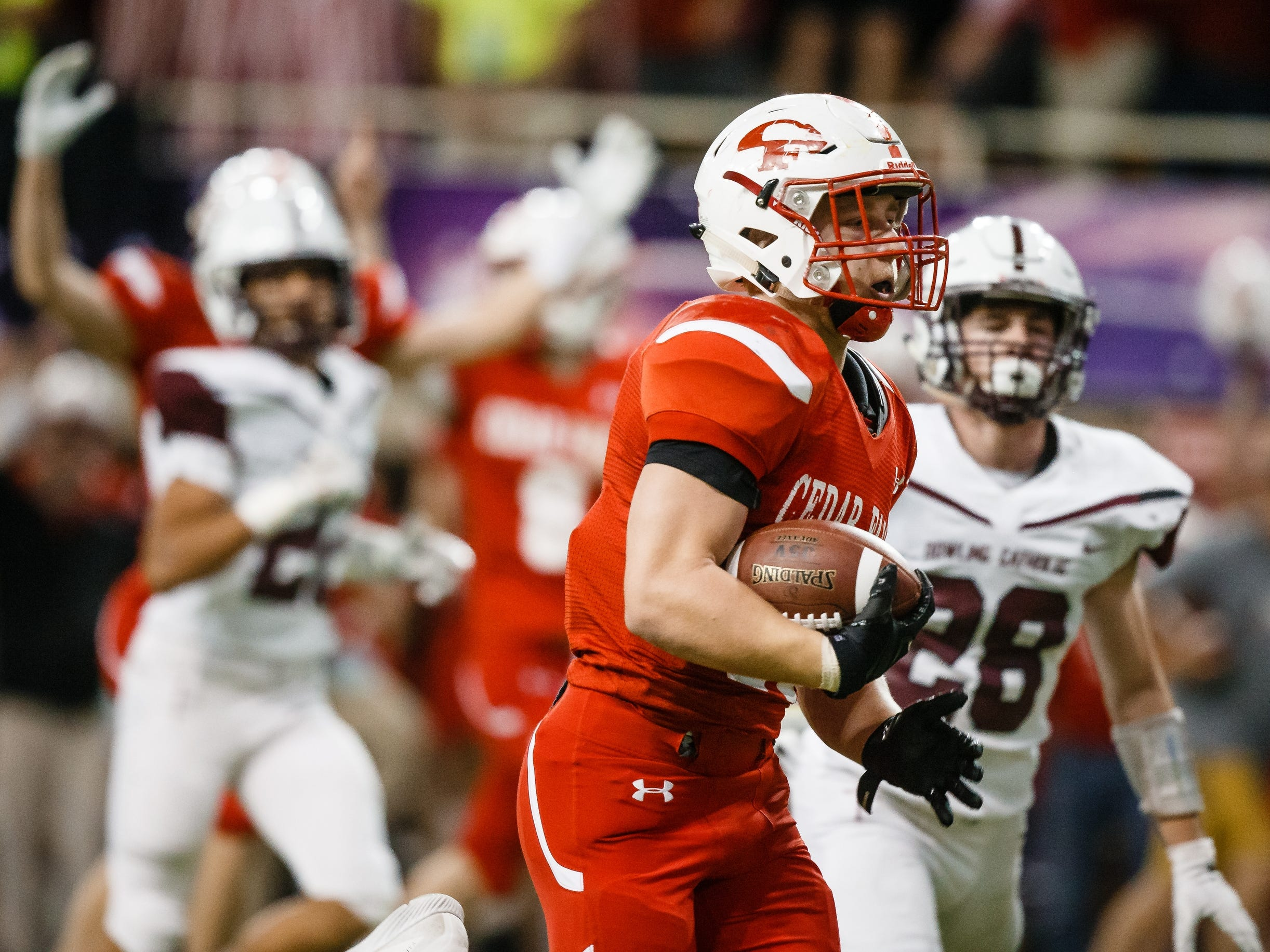 Cedar Falls's Sam Gary (19) runs in for a touchdown to put the Tigers up 6-0 during their class 4A state championship football game against Dowling Catholic on Friday, Nov. 16, 2018, in Cedar Falls. Cedar Falls takes a 13-7 lead into halftime.