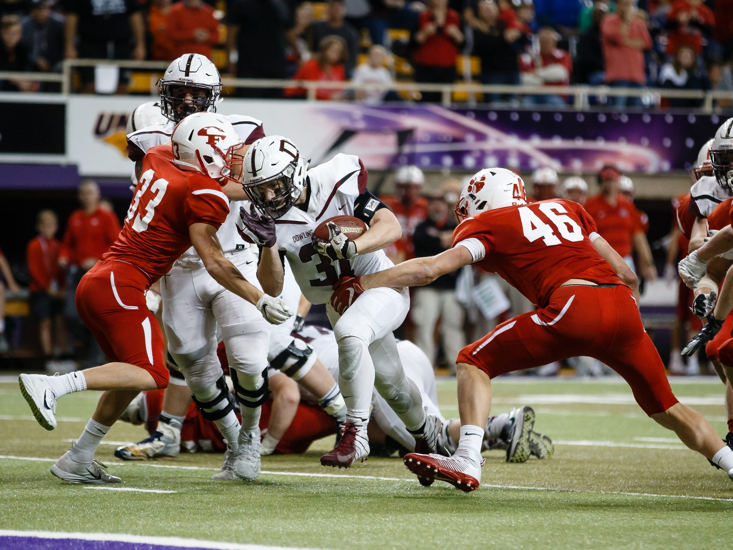 Dowling Catholic's Teagan Johnson (31) runs into the end zone to make the score 13-16 during their class 4A state championship football game on Friday, Nov. 16, 2018, in Cedar Falls. Dowling Catholic would go on to defeat Cedar Falls 22-16 and win their sixth state title.