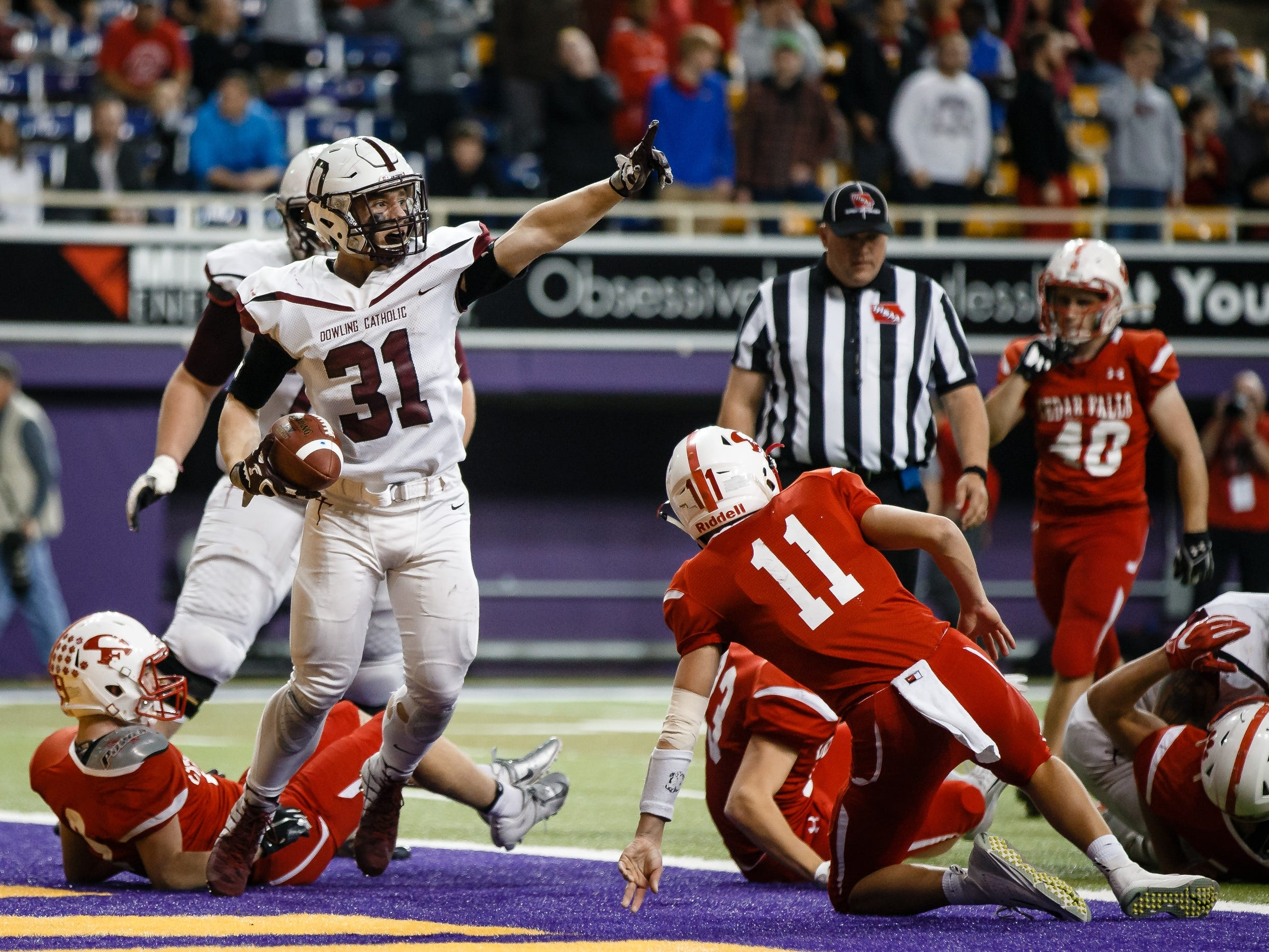 Dowling Catholic's Teagan Johnson (31) celebrates his touchdown making the score 13-16 during their class 4A state championship football game on Friday, Nov. 16, 2018, in Cedar Falls. Dowling Catholic would go on to defeat Cedar Falls 22-16 and win their sixth state title.