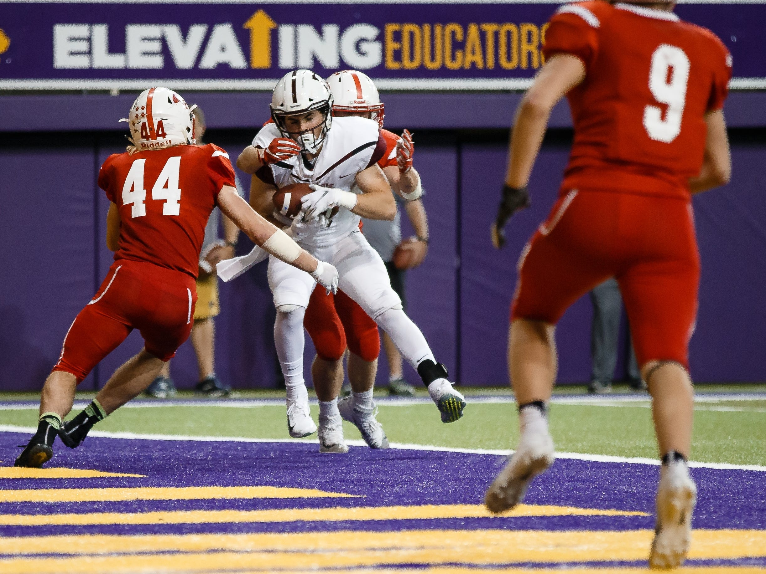 Dowling Catholic's Collin Cook (5) catches a ball in the end zone for a two point conversion making the score 22-16 during their class 4A state championship football game on Friday, Nov. 16, 2018, in Cedar Falls. Dowling Catholic would go on to defeat Cedar Falls 22-16 and win their sixth state title.