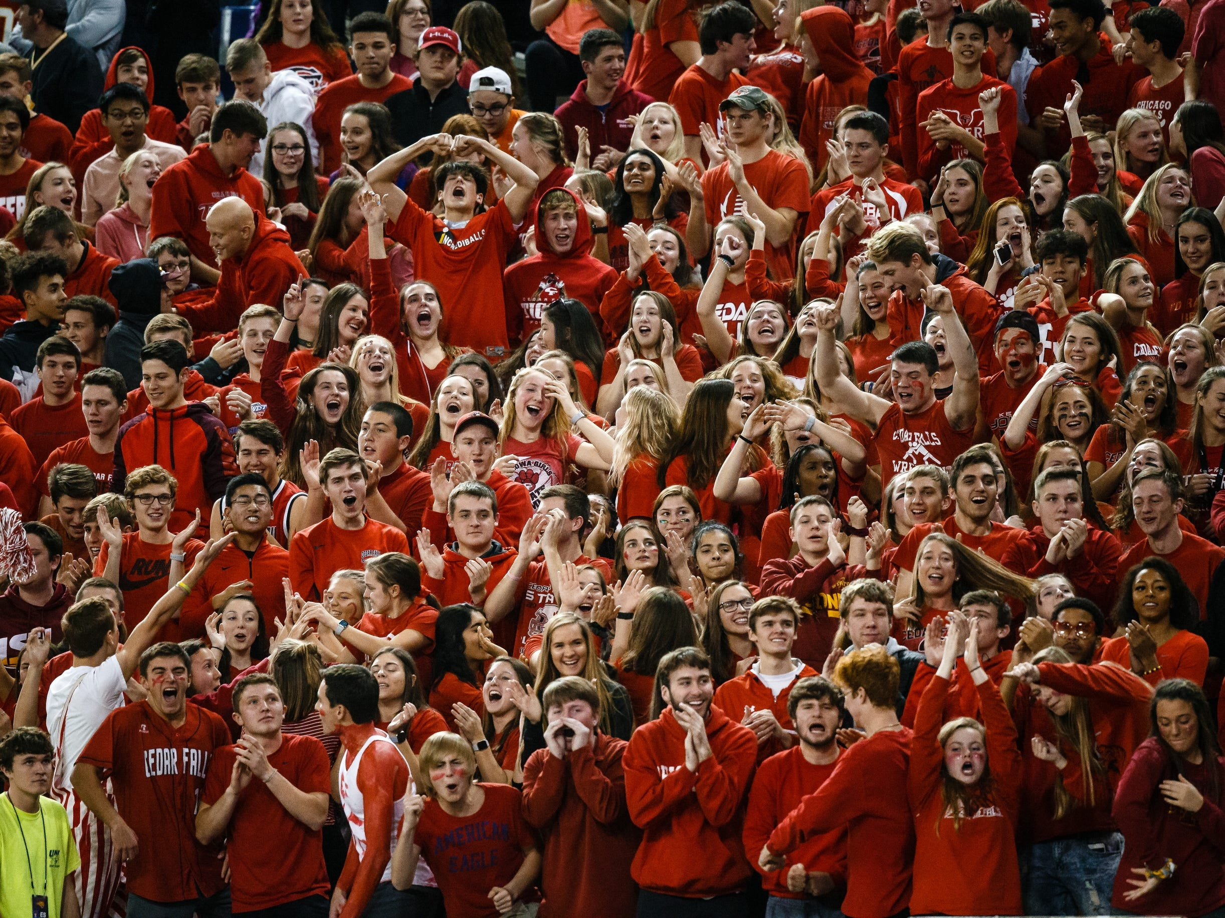 Cedar Falls fans cheer after a touchdown to put the Tigers up 6-0 during their class 4A state championship football game against Dowling Catholic on Friday, Nov. 16, 2018, in Cedar Falls. Cedar Falls takes a 13-7 lead into halftime.